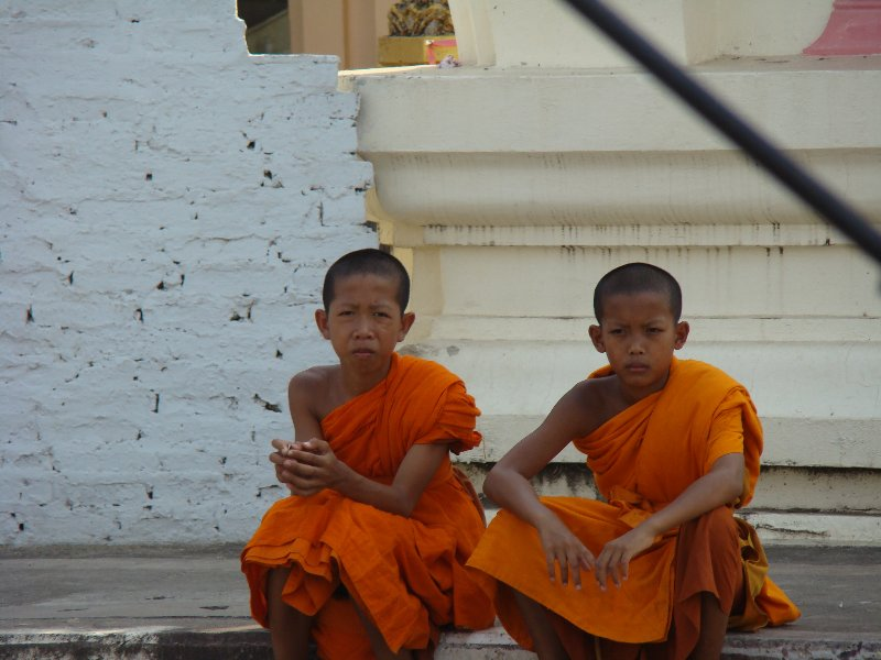 Young monks sitting in front of the Wat