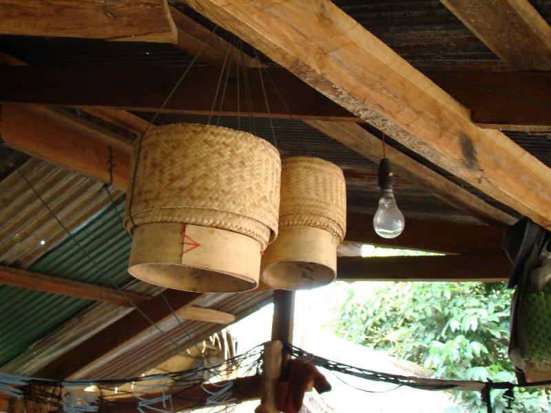 Sticky rice containers hanging in the kitchen