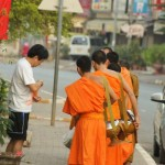 The Buddhist monk receiving line moving down the street