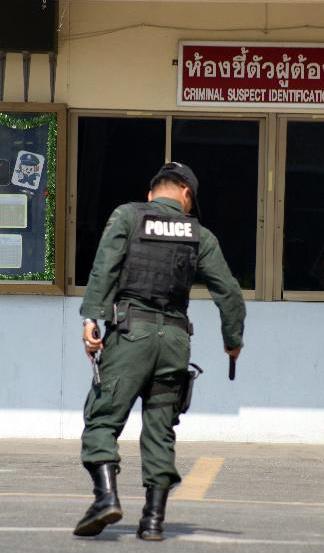 Pattaya SWAT officer with guns drawn